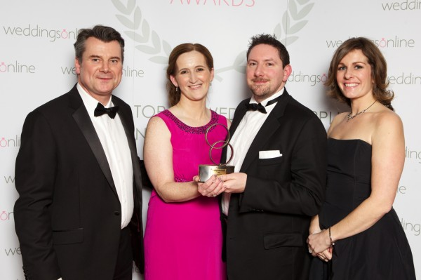 Lead singer Jonathan and Booking Co-ordinator Niamh pick up the Best Band award from WeddingsOnline