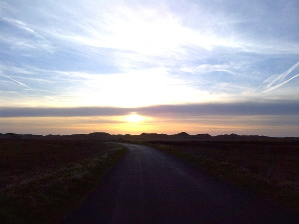 The setting sun on the road to Doonbeg Lodge.